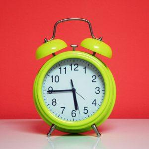 Alarm clock denoting 24 hour turnaround time